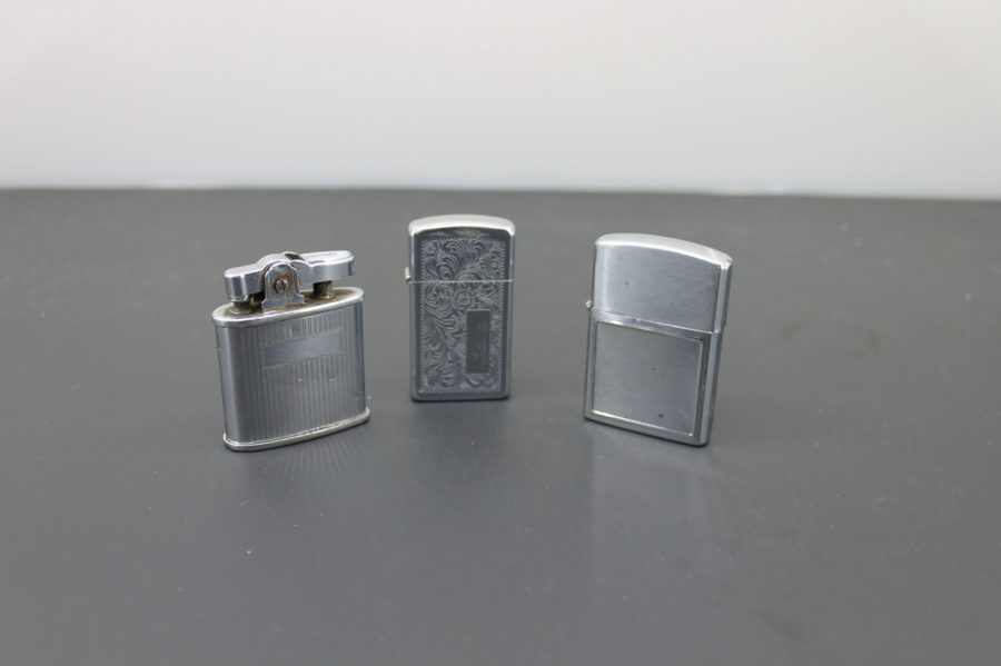 Three Cigarette Lighters for Parts Zippo, Ronson triumph, and a Barlow B54 5
